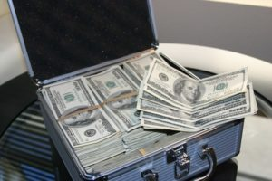 case full of 100 dollar bills