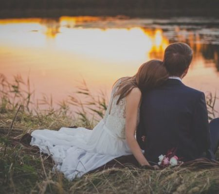 wedding photo of a couple by water