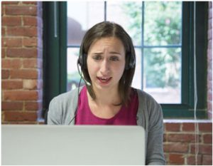 woman talking on headset in an office
